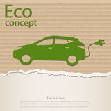 Zielony elektryczny samochód na poszarpanym kartonie Obraz Stock