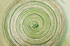 Zielony glosy tło z spirala wzorem obrazy stock