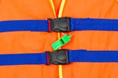 Zielony gwizd na części kamizelka ratunkowa Obrazy Royalty Free