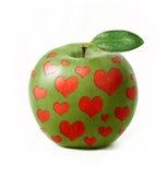 Zielony jabłko odizolowywający z sercami obrazy royalty free
