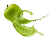 Zielony jabłko z farby pluśnięciem obraz stock