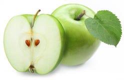 Zielony jabłko z połówką Fotografia Royalty Free