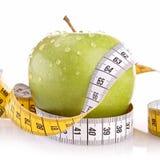 Zielony jabłko i metr Fotografia Royalty Free
