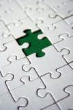 zielony kawałek jigsawa obrazy stock
