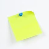 Zielony majcher na białej desce od zawiadomienia Obraz Royalty Free
