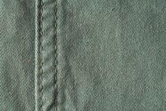 Zielony materiał - drelichowi cajgi obrazy stock