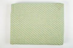 Zielony naczynie ręcznik z lampasami obrazy royalty free