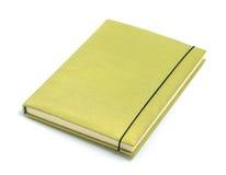 Zielony notatnik na białym tle Fotografia Royalty Free