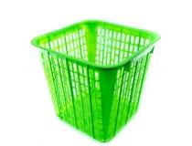 Zielony plastikowy kosz na białym tle Zdjęcia Stock