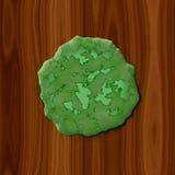 Zielony przegniły śluzowacieje na drewnianym tle Zdjęcie Stock