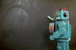 Zielony robota nauczyciela ot blackboard Obrazy Stock