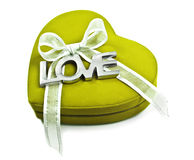 Zielony serce z słowo miłością literującą out w srebrze na bielu Obrazy Stock