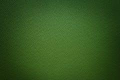 Zielony syntetyczny rzemienny tło z winietą Fotografia Stock