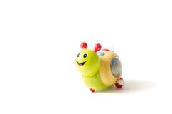 Zielony szczęśliwy ślimaczek odizolowywający na białym tle Fotografia Stock
