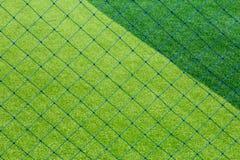 Zielony sztuczny trawy boisko do piłki nożnej dla tła Fotografia Royalty Free