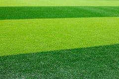 Zielony sztuczny trawy boisko do piłki nożnej dla tła Fotografia Stock