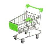 Zielony wózek na zakupy na bielu Zdjęcia Royalty Free