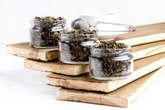 Zielonych Herbat piłek Oolong zielona herbata z lotosową zieloną herbatą z imbirową rozmaitością zielona herbata w szklanego słoj Obrazy Stock