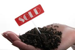 ziemia sprzedawane ręce Fotografia Stock