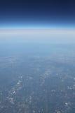 Ziemska linia brzegowa i od samolotu niebo głęboka przestrzeń Obrazy Stock