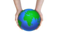 Ziemska planeta w żeńskich rękach Zdjęcie Stock
