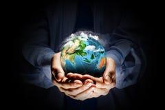 Ziemska planeta w rękach Fotografia Royalty Free