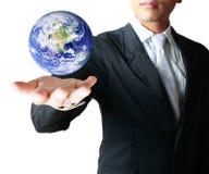 ziemskiej kuli ziemskiej rozjarzone ręki jego mienie Zdjęcia Royalty Free