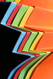 Zig Zag. Folded bright coloured papers in a zig zag pattern stock image