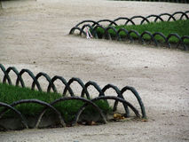 Zig Zag Garden Path. With metal arc boundaries.  Photo taken while walking through a garden in Paris, France Royalty Free Stock Photos