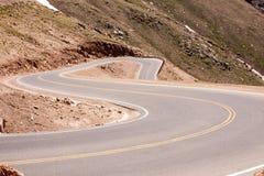 Zig-zag iść drogowy w dół Szczupaka Szczyt Zdjęcia Royalty Free