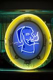 Zig Zag Man logo on a neon sign. The Zig Zag Man was one of the most popular tattoo designs from the 1960s. He is the most recognizable man with the beard, hat stock image