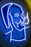 Zig Zag Man logo on a neon sign. The Zig Zag Man was one of the most popular tattoo designs from the 1960s. He is the most recognizable man with the beard, hat stock photo
