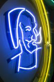 Zig Zag Man logo on a neon sign. The Zig Zag Man was one of the most popular tattoo designs from the 1960s. He is the most recognizable man with the beard, hat royalty free stock images
