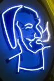 Zig Zag -Mensenembleem op een neonteken stock foto