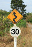 Zig Zag road warning sign and 30km limit speed limit Royalty Free Stock Photos