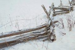 Zig zag rustic cedar rail fence with snow dusting Stock Photography