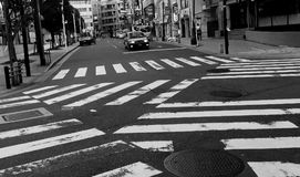 Zig-zag zebra cross in tokyo city, japan Royalty Free Stock Photos