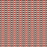 Zigzag abstract background. Red colors seamless pattern with repeated stylized triangles mosaic. Modern style texture. Royalty Free Stock Photo