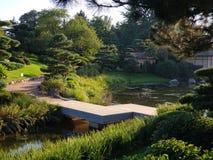 Zigzag bridge in Japanese garden. Zigzag stone bridge in a traditional Japanese garden Stock Photos