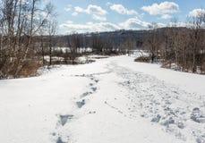 Zigzag footprints in deep snow Royalty Free Stock Photos