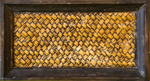 Zigzag interlocking of handcraft bamboo weave texture natural wi. Cker background on wood frame Stock Photos