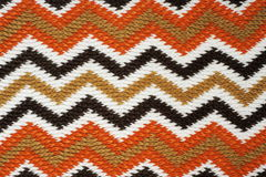 Zigzag knitting work. Striped fall color knitting work Stock Photos