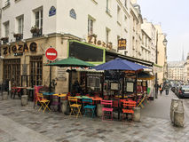 ZigZag Paris cafe with colorful outdoor tables and chairs Royalty Free Stock Photo