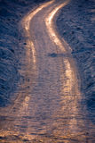 Zigzag path. Winter country zigzag path with slippery snow and sunset reflection Stock Photography