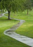 Zigzag path. Zigzag golf cart path in the rain royalty free stock photos