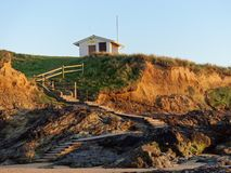 Zigzag Path to Hut. A zigzag path leading up to a hut by the beach royalty free stock photo