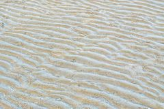 A curved pattern of beautiful sand beach stock images
