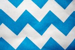 Zigzag pattern. Seamless blue and white zigzag pattern on fabric stock image