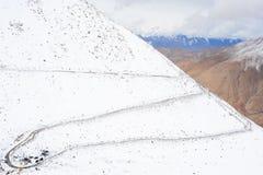 Zigzag road to Chanla Pass and Pangong Lake Stock Photos