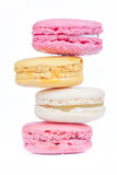 Zigzag row of sweet colorful macaroons on white background. Royalty Free Stock Images